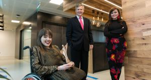 Izzy and Ailbhe Keane, founders of Izzy Wheels and winners of the 2017 Accenture Leaders of Tomorrow competition, with Alastair Blair, Country Managing Director, Accenture Ireland. Photograph: Shane O'Neill