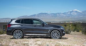 The new BMW X3 looks generally similar to the outgoing model, but takes on the bigger grille and more upright lights of the smaller X1
