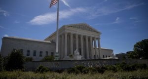 A flag flies outside the US supreme court after it was announced that the court will allow a limited version of Donald Trump's travel ban to take effect. Photograph: Eric Thayer/Getty