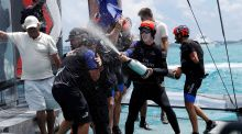 Emirates Team New Zealand helmsman Peter Burling celebrates as he sprays team-mates after defeating Oracle Team USA in race nine to win the America's Cup in Hamilton, Bermuda. Photograph: Mike Segar/Reuters
