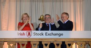 AIB chief executive Bernard Byrne rings the bell at the Irish Stock Exchange with Deirdre Somers, Irish Stock Exchange chief executive and AIB chairman Richard Pym as formal trading commenced in the bank's shares following last week's IPO. Photograph: Dara Mac Donaill / The Irish Times