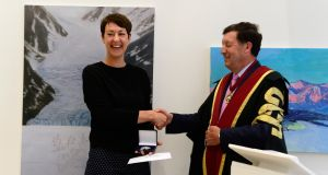 Artist Miranda Blennerhassett receives the RCSI silver medal from Prof John Hyland. Photograph: Cyril Byrne