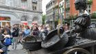 Tourists in Dublin survey the Molly Malone Statue earlier this month. Photograph: Alan Betson