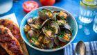Serve the clams with the tomato toasts to mop up the sauce