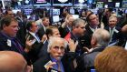 In New York the S&P 500 and the Dow Jones Industrial Average pared early losses in late morning trading