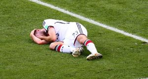 Germany's Christoph Kramer lies on the pitch after a collision during the 2014 World Cup  Final against  Argentina at the Maracana  in Rio de Janeiro. Photograph: Robert Cianflone/Getty Images