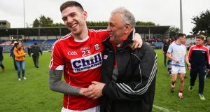 Cork manager Peadar Healy celebrates the  semi-final victory over Tipperary with Luke Connolly at  Páirc Uí Rinn. Cork always have hope when they play Kerry. Always. Photograph: Tommy Dickson/Inpho