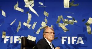Former Fifa president Sepp Blatter is showered with fake banknotes at a press conference in 2015. Photograph: Arnd Wiegmann/Reuters