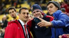 Sam Warburton of the Lions poses for a selfie with fans after the Lions' draw with the Hurricanes. Photo: Hagen Hopkins/Getty Images