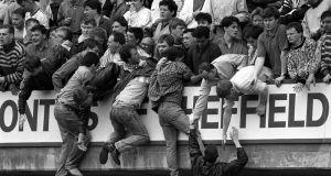 Liverpool fans trying to escape during the Hillsborough disaster at Hillsborough football stadium in Sheffield. Photograph: David Giles/PA Wire