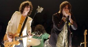 Julian Casablancas,  Nick Valensi and drummer Fabrizio Moretti of The Strokes performing in New York in 2002. Photograph: J Vespa/WireImage