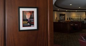 Framed portrait of President Donald Trump on the cover of a Time Magazine hanging from a column in the Champions Sports Bar & Grill at the Trump National Doral Miami. Photograph: The Washington Post/Getty Images
