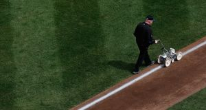 Pete Flynn prepares the field for the game between the Philadelphia Phillies and the New York Mets during the last home match at Shea Stadium on April 8th, 2008. Photograph: Photograph:  Nick Laham/Getty Images