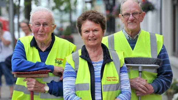 Community volunteers Andrew O'Dea, Leana McCarthy and Nicolas Hickey in Kildorrery, Co Cork. Photograph: Daragh Mc Sweeney/Provision