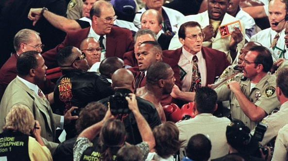 Mike Tyson confronts police officers after he was disqualified for biting Evander Holyfield. Photograph: Mike Nelson/Getty/AFP
