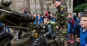 TANK BOY: Christopher Nolan  (7) from St Joseph's NS Kilcock participates in some tank manoeuvres under the supervision of Cpl  James Tourmey 2nd Artillery Regiment Athlone during the launch of 'Fuchsia 2017' a fundraiser for homeless members of the Defence Forces at Merrion Square, Dublin. Photograph: Brenda Fitzsimons