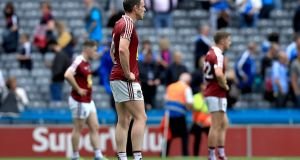 Dejected Westmeath players following the heavy Leinster semi-final defeat  to Dublin in Croke Park. Photograph: Donall Farmer/Inpho