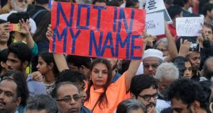 Bollywood actor Shabana Azmi holds a placard  during a protest in Mumbai on Wednesday against a spate of violent attacks across the country. Photograph: Rafiq Maqbool/AP