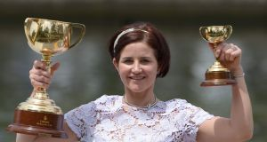 Michelle Payne, the first woman jockey to win the Melbourne Cup, has been handed a four-week ban after testing positive for a banned substance. Photograph: Mal Fairclough/AFP