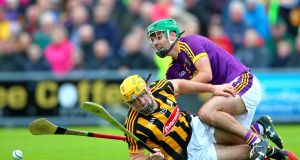 Kilkenny's Colin Fennelly with  Shaun Murphy of Wexford. Murphy provides the cover as his fellow defenders augment the team's attack. Photograph: James Crombie/Inpho