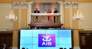 Bernard Byrne, AIB chief executive, rings the bell at the Irish Stock Exchange with Deirdre Somers, Irish Stock Exchange chief executive, and Richard Pym, chairman AIB. Photograph: Dara Mac Dónaill