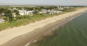 "Rosslare Strand: known locally as ""the real Rosslare"", during the summer months the village increases from a population of about 1,500 to 17,000"