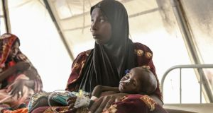 A woman cradles her daughter at an MSF clinic for malnourished children in Gwange, Maiduguri, northeast Nigeria. Photograph: Sally Hayden