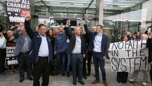 Jobstown trial defendants Michael Banks, Ken Purcell, Paul Murphy TD and Scott Masterson leave the Dublin Circuit Criminal Court after they were all found not guilty on charges of the false imprisonment of then tánaiste Joan Burton at a water protest in 2014. Photograph: Collins Courts