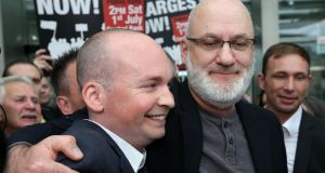 Defendants in the Jobstown trial Paul Murphy TD (left) and Cllr Michael Murphy celebrate as they leave the Dublin Circuit Criminal Court on Thursday. Photograph:  Collins Courts