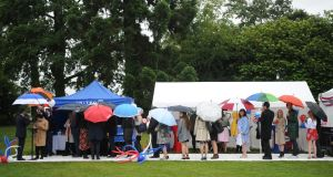 Guests shelter from rain at the Independence Party held in the US Ambassadors residence in the Phoenix Park on Thursday night. Photograph: Aidan Crawley/The Irish Times