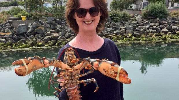 Marie Claire Digby, back on terra firma, displays a freshly caught lobster. It takes seven years for a lobster to reach maturity. Photograph: Dara Mac Dónaill