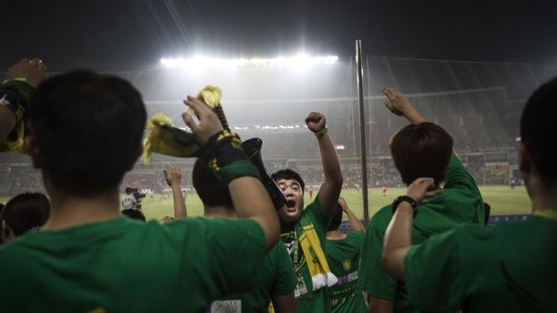 Ultra supporters of Beijing Guoan. Photograph: Kevin Frayer/Getty Images