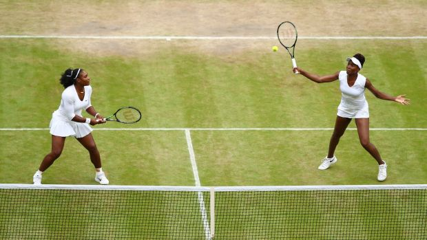 Serena and Venus Williams in action during last year's women's doubles final at Wimbledon. Photograph: Julian Finney/Getty Images