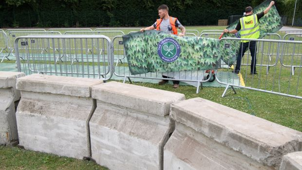 Concrete bollards and security gates are seen in the public queueing zone outside Wimbledon. Following the terror attacks on London, this year's tournament will see increased security measures to protect visitors. Photograph: Leon Neal/Getty Images