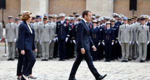 Emmanuel Macron walks with defence minister Florence Parly during a medal presentation ceremony  at the Hotel des Invalides, in Paris, on Friday. Photograph: Thibault Camus/EPA