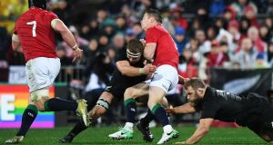 Sam Cane puts in a hit for the All Blacks against the Lions. Photo: Andrew Cornaga/Inpho