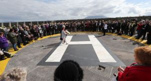 Vera Cusack and Bernie Naughton from the Rosscommon Solstice Choir lay a wreath for the crew of the Irish Coast Guard helicopter crash Rescue 116 at the helipad in Blacksod Harbour. File photograph: Niall Carson/PA Wire