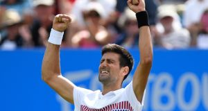 Novak Djokovic  celebrates victory  against Gael Monfils in the final of the   Aegon International Eastbourne at Devonshire Park Lawn Tennis Club. Photograph: Mike Hewitt/Getty Images