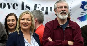 Sinn Féin president Gerry Adams and the party's Northern leader Michelle O'Neill join demonstrators demanding equal marriage legislation at an event in Belfast. Photograph: Clodagh Kilcoyne/Reuters