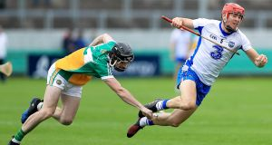 Offaly's Ben Conneely in action against  Barry Coughlan of Waterford during the  All-Ireland Senior Hurling Championship round one qualifier at  O'Connor Park in Tullamore. Photograph: Donall Farmer/Inpho