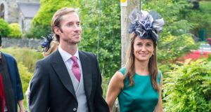 Pippa Middleton and her husband James Matthews attend the wedding of Camilla Campion-Awwad and Oliver Jenkinson at Sacred Heart Church in Glengarriff, west Cork. Photograph:  Provision
