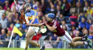 Westmeath's Gary Greville blocks down Tipperary's Aidan McCormack during the All-Ireland Round One Hurling qualifier at  Semple Stadium. Photograph: Ken Sutton/Inpho