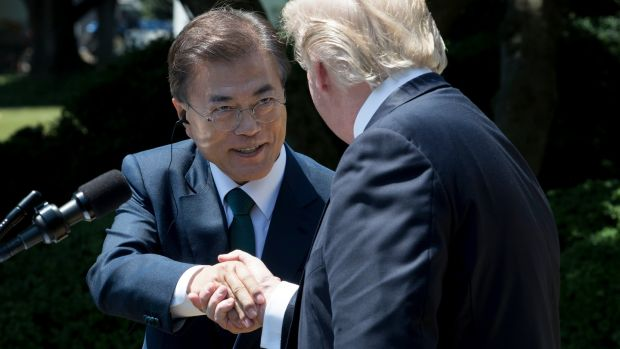 US president Donald Trump (right) and president of South Korea Moon Jae-in shake hands while delivering joint statements in the Rose Garden of the White House in Washington at the end of June 2017. Photograph: EPA