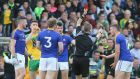 Longford's James McGivney receives a red card from referee Padraig Hughes, a decision Denis Connerton  felt cost Longford the match. Photograph: Lorcan Doherty/Inpho