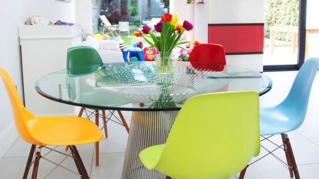 This wire frame glass top table is a copy of the 1966 design by Warren Platner. It is surrounded by replicas of the Eames DSW chair, in a rainbow of colours. Photograph: Emily Quinn