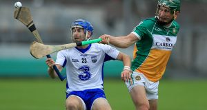 Offaly's David King challenges Colin Dunford of Waterford. Photograph: Donall Farmer/Inpho