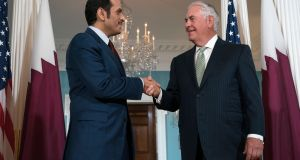 US secretary of state Rex Tillerson shakes hands with Qatari foreign minister Sheikh Mohammed bin Abdulrahman Al Thani prior to a meeting at the State Department in Washington, DC, on Tuesday. Photograph: Shawn Thew/EPA