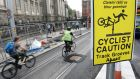 Caution signs at  the Luas track on  College Green, Dublin. Photograph: Dara Mac Dónaill/The Irish Times