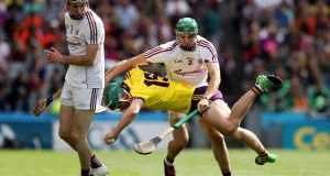 Galway's Adrian Tuohey upends Harry Kehoe of Wexford. Photograph: Tommy Dickson/Inpho