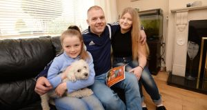 Daniel O'Connor with his daughters, Stacy and Sophie, at their home in Tallaght. Photograph: Alan Betson